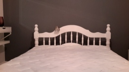 Newly painted bed frame in white