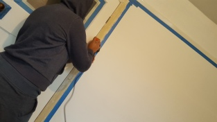 Sanding the door frame